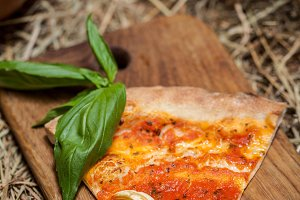 Pizza slice with tomato sauce