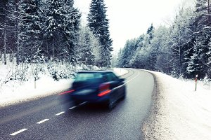 Car on the road in winter landscape