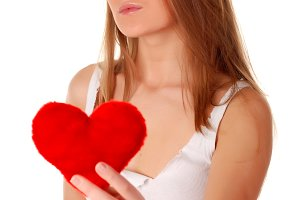woman holding artificial red heart
