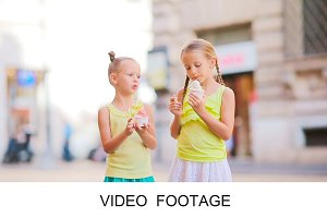 Adorable girls eating ice-cream