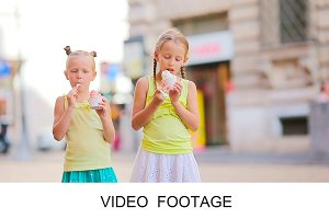 Cute kids enjoying ice-cream summer
