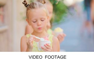Cute kids eating ice-cream outdoors