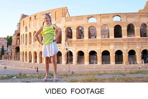 Adorable girl in front of Colosseum