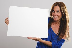 Attractive woman holding  white sign