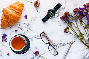 Tea and croissant, flatlay