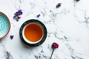 Tea on white marble table, flat lay