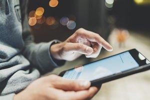 Male hands using digital tablet