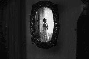 Bride in the vintage mirror