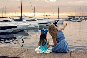 mother and daughter three years in a blue dress   big bow