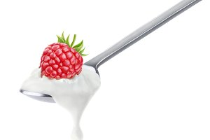 Raspberry yogurt on spoon, isolated