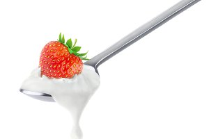 Strawberry yogurt on spoon, isolated