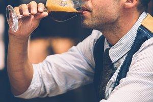Man drinks coffee from wine glass