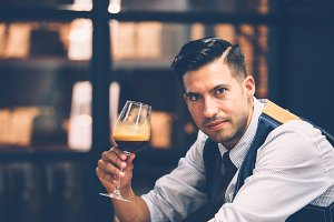 Handsome man with coffee in glass