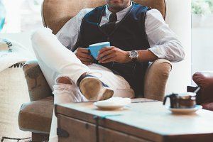 Handsome elegant man with coffee cup