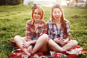 Two Young Smiling Hipster Girls