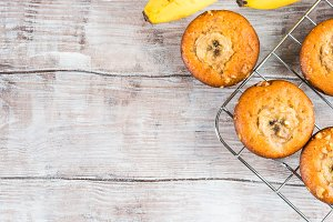 Wooden background with banana muffin