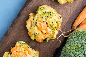 Vegetarian patties with carrots and broccoli. Square