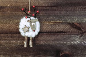 Reindeer christmas on dark wooden