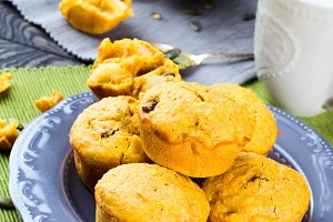 Pumpkin and apple muffins. Vertical