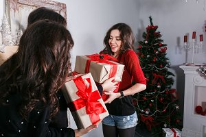 Beautiful girl exchange gifts