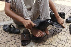 Hands polish leather black shoes