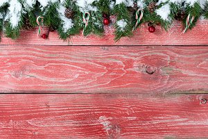 Red rustic wood with snowy firs