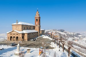 Old church and snowy hills of Italy.