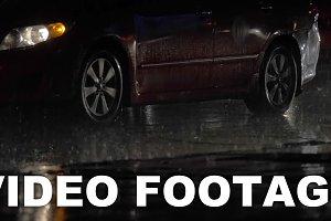 Car traffic at rainy night