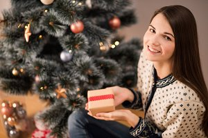 Girl near christmas tree