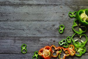 Photo of sliced peppers over wooden table