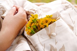 Woman holding bag with yellow flowers