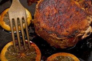 pork chop seared on cast iron pan