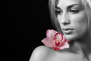 woman with delicate orchid