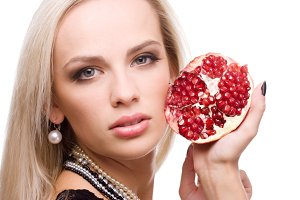 woman with fresh red pomegranate