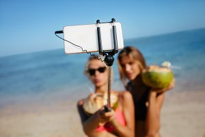 Friends taking selfie on beach