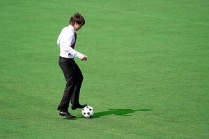 Man in suit playing in football
