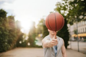 Man balancing basketball