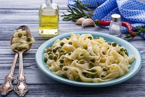 Homemade pasta with green peas