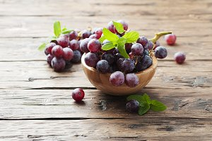 Sweet red grapes on the wooden table