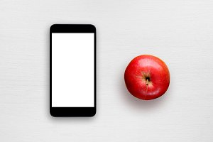 Smartphone and red apple