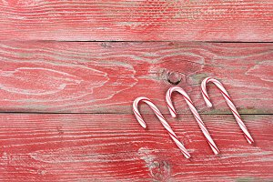 Holiday Candy Canes on Red Wood