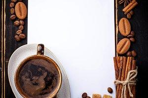 Coffee, cinnamon, open notebook