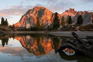 Autumn scenery by Dolomites lake
