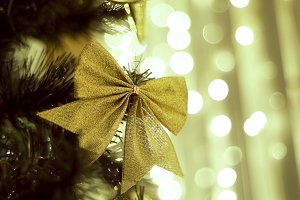 Decorated Christmas tree on blurred background, sparkling and fairy