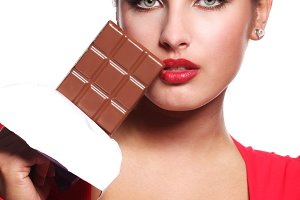woman in red dress eating chocolate