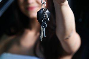 woman showing new car keys
