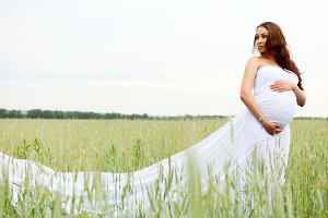 pregnant woman in the field