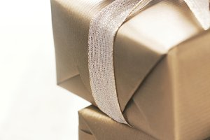 Golden paper elegant gifts with bow