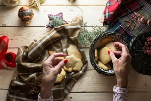 Hands taking Christmas cookies