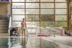 swimmer water pool indoors posing